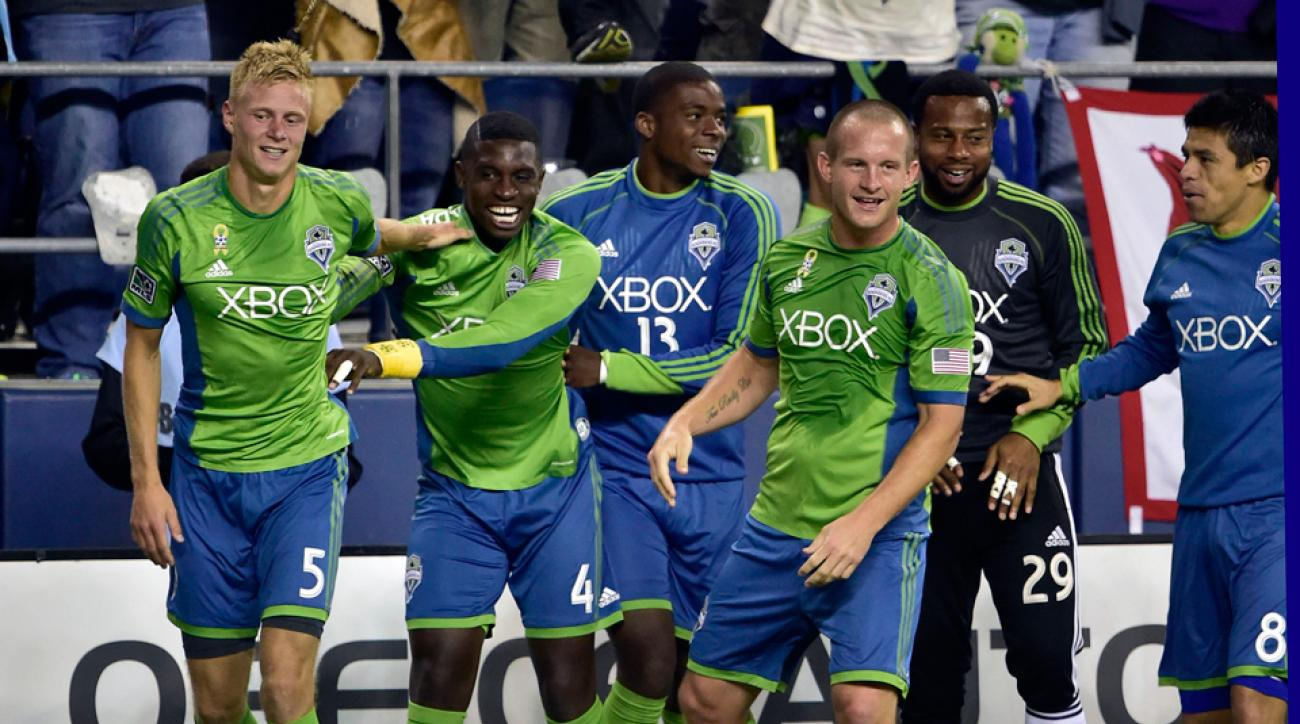 Andy Rose, left, was the hero for Seattle against Real Salt Lake, scoring a last-minute goal to lift the Sounders to a riveting 3-2 win.