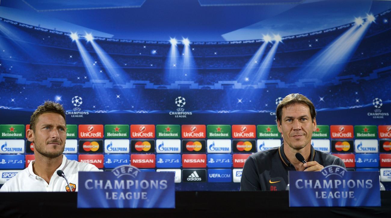AS Roma captain Francesco Totti and coach Rudi Garcia give a press conference.