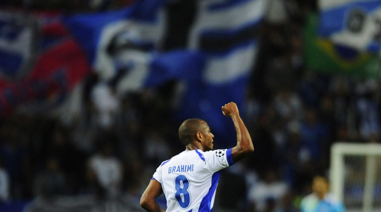 Yacine Brahimi scored a hat trick in his Champions League debut in Porto's 6-0 win over Belarusian side BATE Borisov.