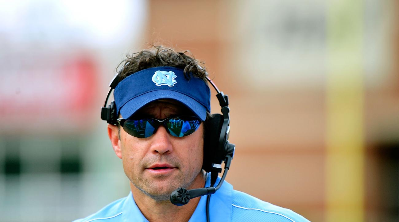 Head coach Larry Fedora of the North Carolina Tar Heels watches his team against the Louisville Cardinals during play on September 15, 2012 in Louisville, Kentucky.