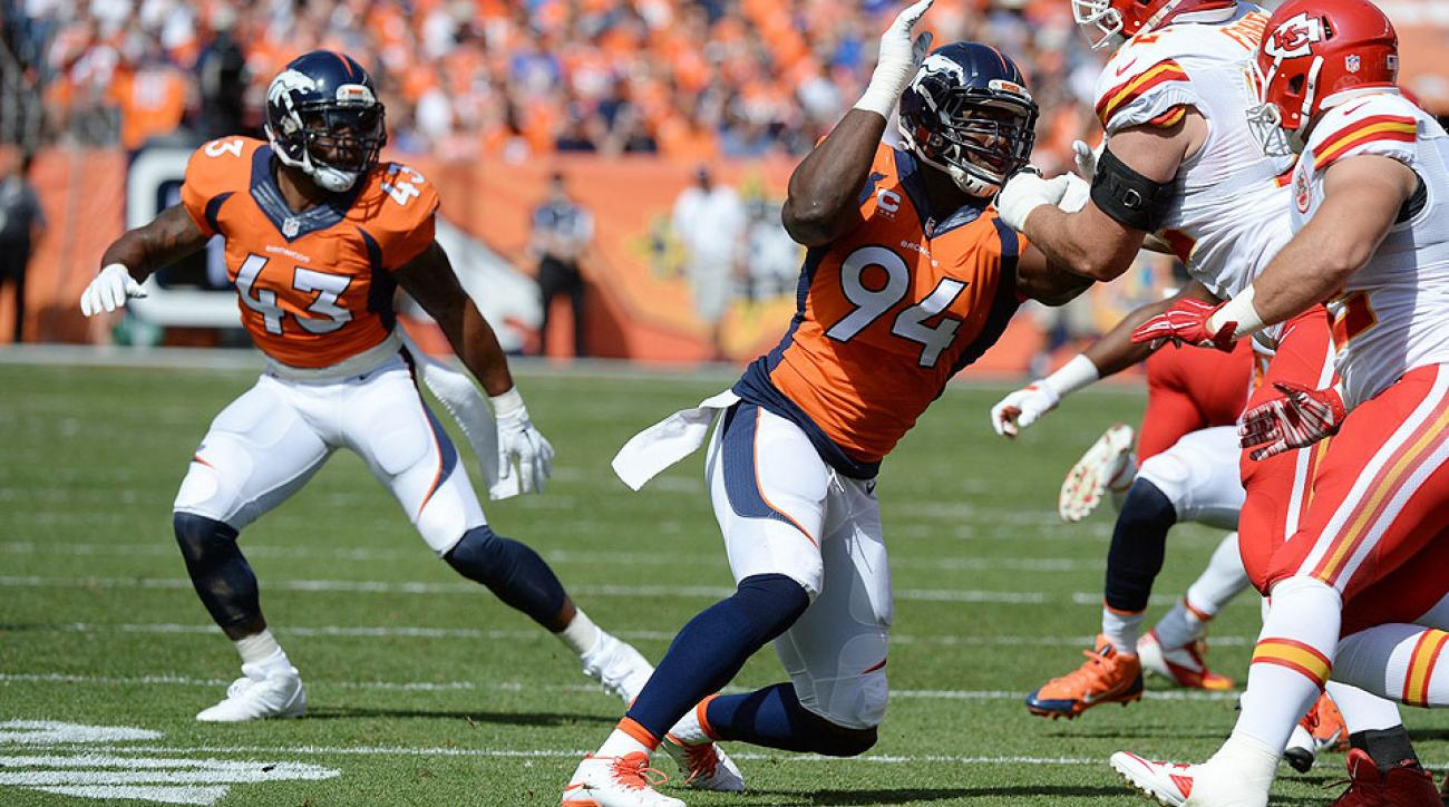 T.J. Ward (43) and DeMarcus Ware (94) are two of the 10 new faces within the Broncos' 12 defensive regulars.
