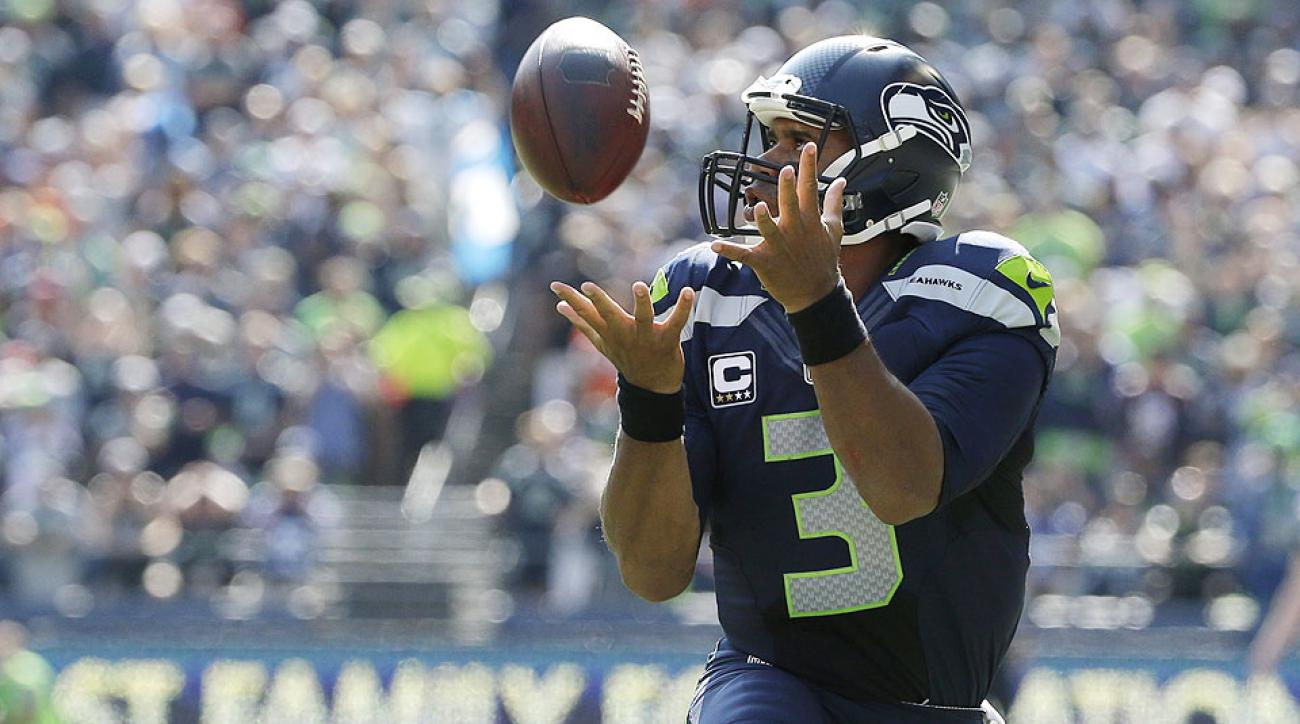 NFL Week 3: Russell Wilson catches pass off trick play during Seahawks-Broncos