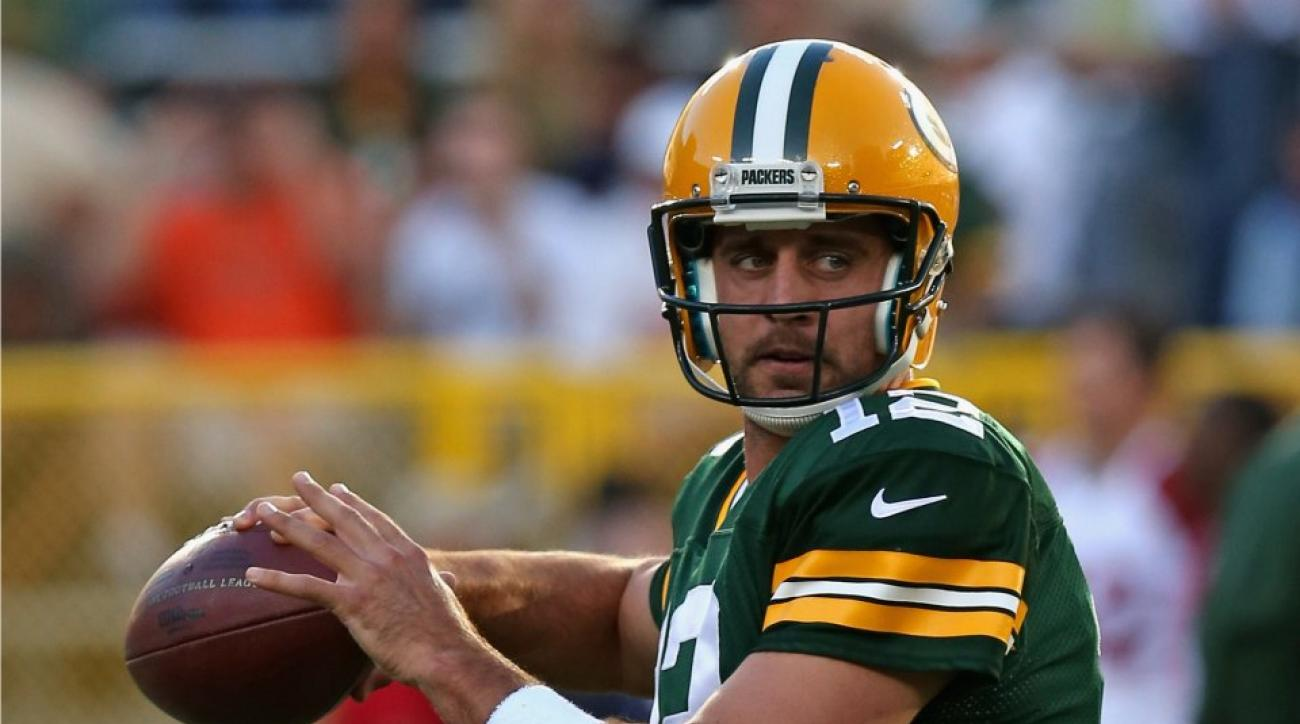 Green Bay's Aaron Rodgers surprises a young pediatric cancer advocate
