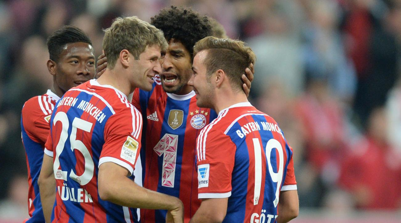 Bayern Munich's Mario Gotze (19) is congratulated after scoring one of his two goals against Paderborn on Tuesday.