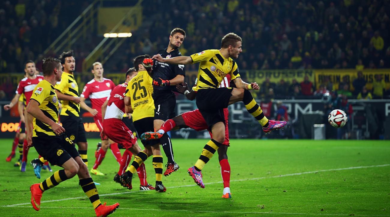 Ciro Immobile, right, scores an equalizer for Borussia Dortmund against Stuttgart in Bundesliga action on Wednesday.