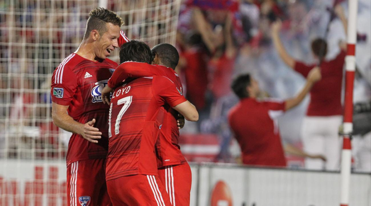 Michel, Zach Loyd and Andres Escobar celebrate one of FC Dallas' goals in a 3-1 win over the Seattle Sounders Wednesday night.