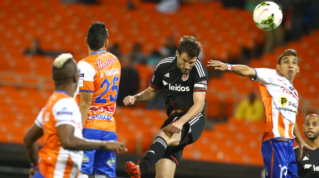 D.C. United's Chris Pontius heads home the opening goal in a 2-0 victory over Tauro FC in the CONCACAF Champions League.