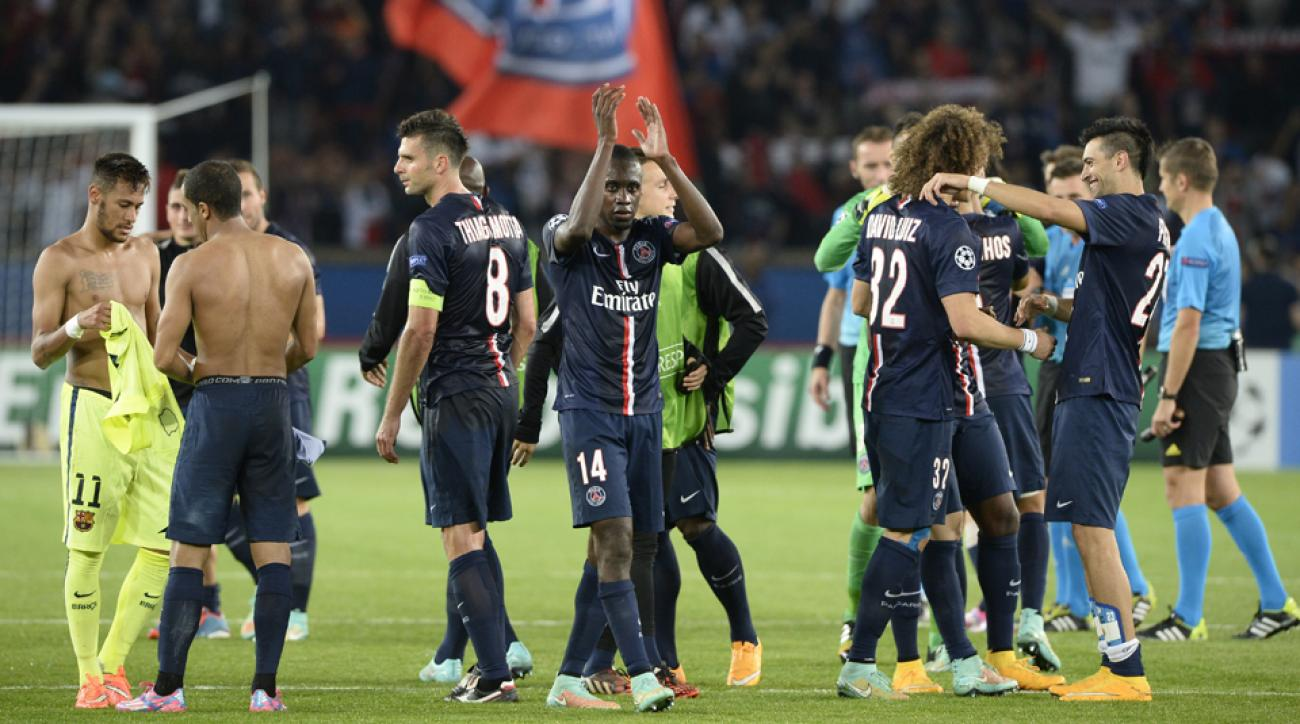 Blaise Matuidi (14), whose goal wound up being the difference, applauds the PSG supporters after his club's 3-2 win over Barcelona in the Champions League.