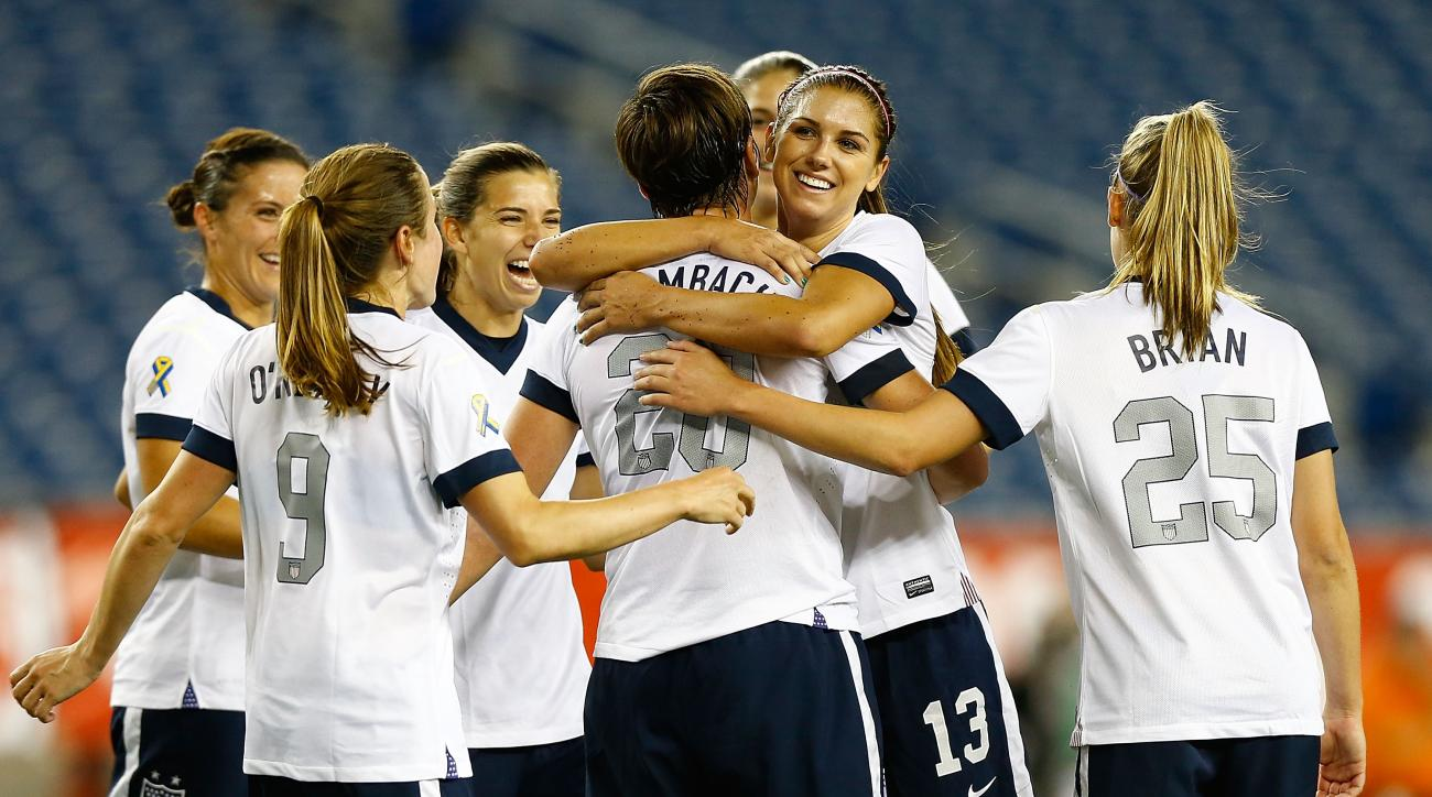 United States women's national team forward Abby Wambach is congratulated by teammates after scoring a goal on a penalty kick late in the second half against Korea Republic during the game at Gillette Stadium on June 15, 2013 in Foxboro, Massachusetts.