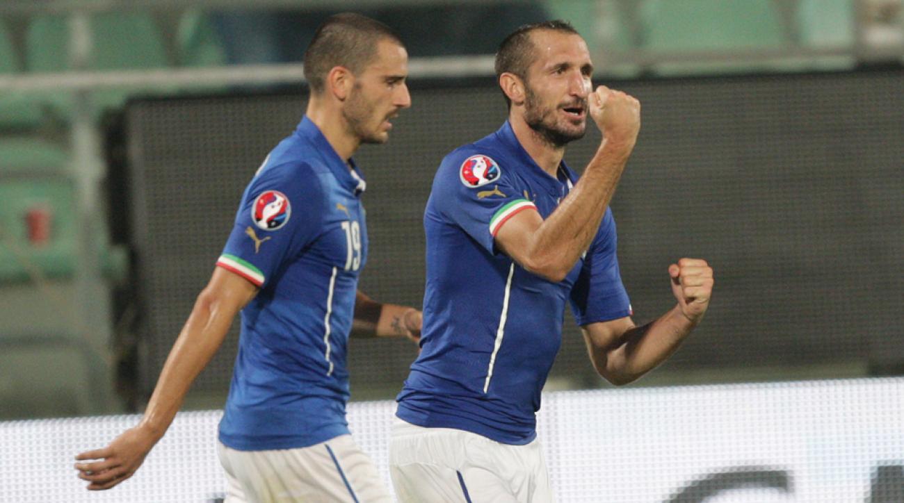 Giorgio Chiellini, right, celebrates one of his two goals for Italy in a Euro 2016 qualifying win over Azerbaijan