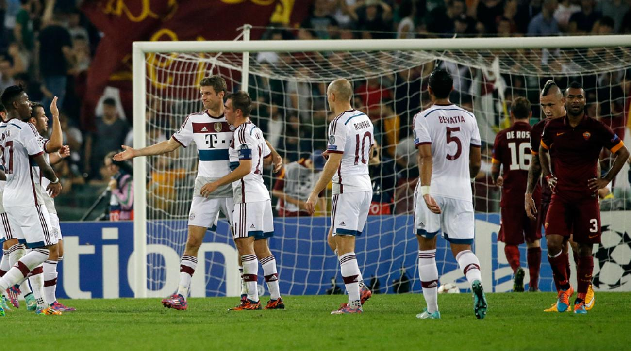 Bayern Munich celebrates while Roma defenders can only put their hands on their hips in a one-sided Champions League encounter.