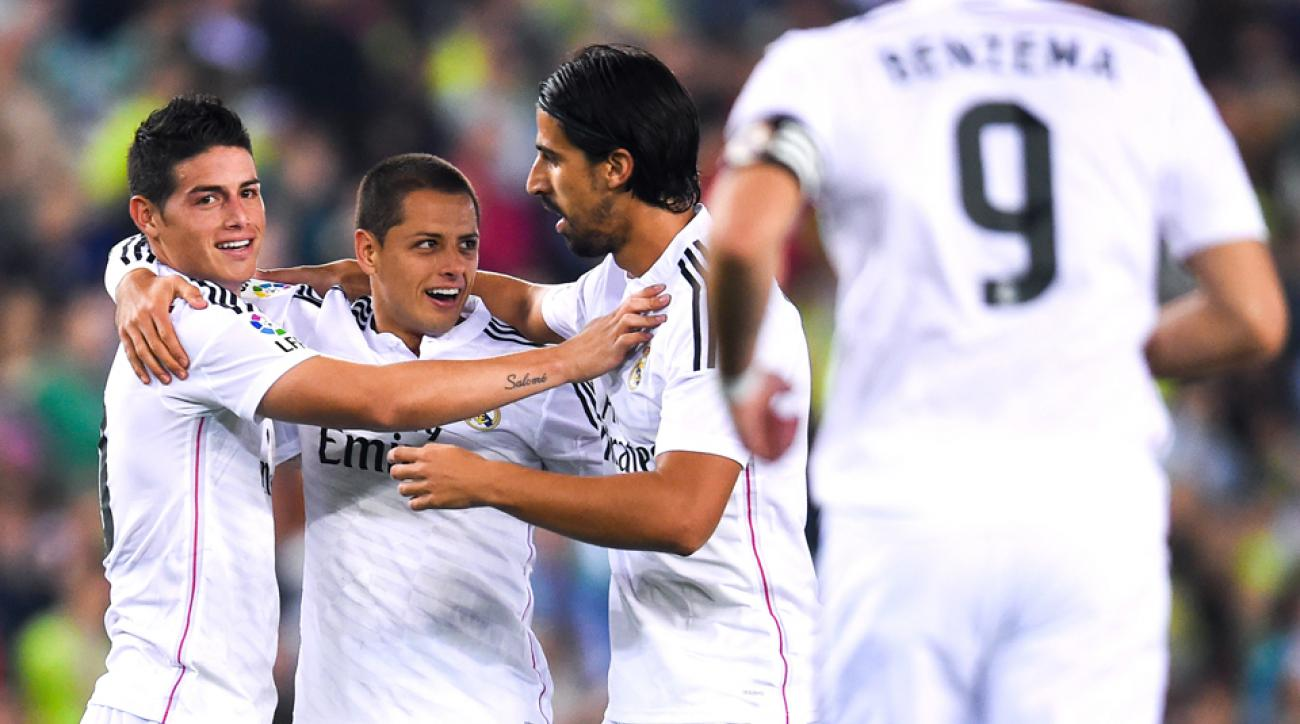 """Javier """"Chicharito"""" Hernandez, second from left, celebrates his Copa del Rey goal with James Rodriguez and Sami Khedira during Real Madrid's 4-1 win over Cornella."""
