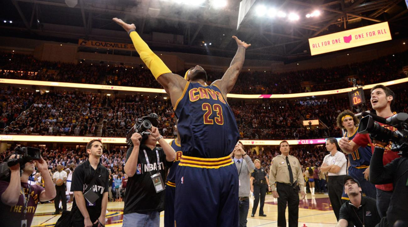 LeBron James opened the Cavaliers' season with his signature chalk toss.