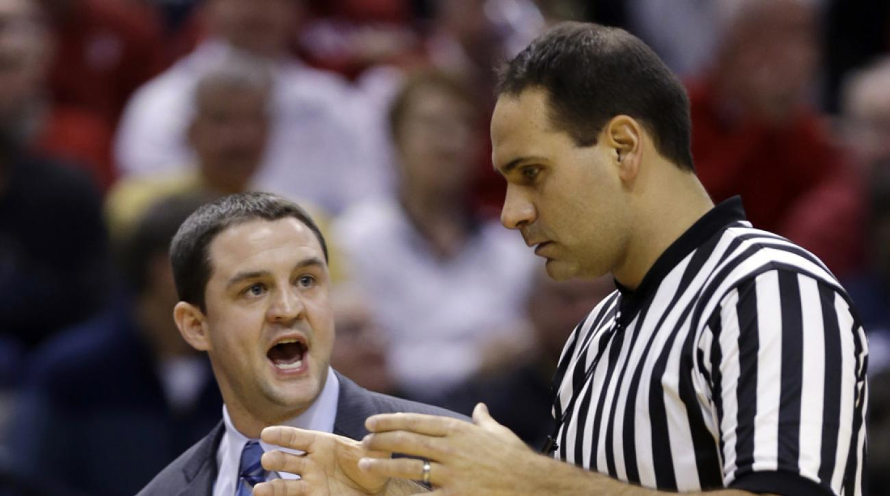 Official Bo Boroski, seen here with Butler head coach Brandon Miller, was disciplined for accessing information on a referreeing website.