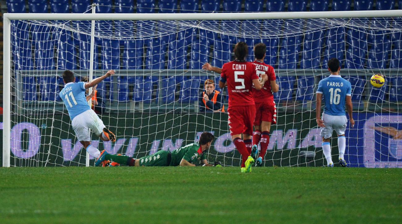 Miroslav Klose (11) scores one of his two goals for Lazio against Cagliari in Serie A action.