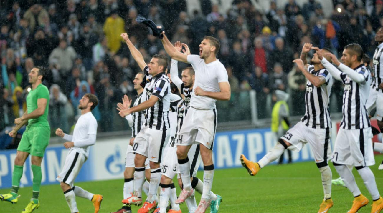 Juventus players salute their fans after a thrilling 3-2 Champions League win over Olympiakos.