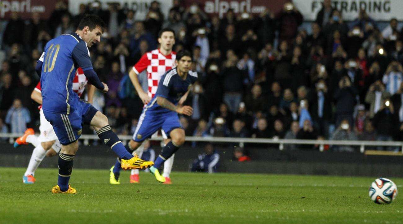 Lionel Messi slots home his game-winning penalty for Argentina against Croatia on Wednesday.