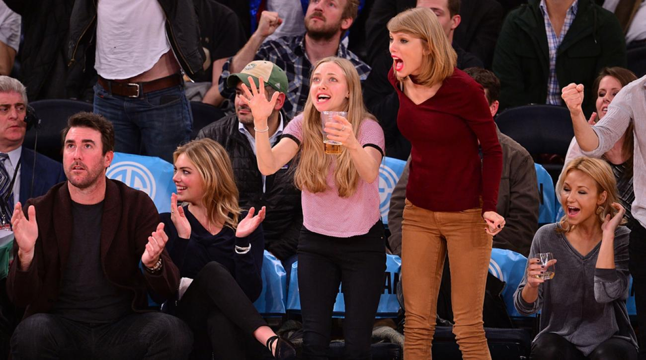 Die-hard Knicks fan Taylor Swift (in red) watches a game with Justin Verlander, Kate Upton and Amanda Seyfried.