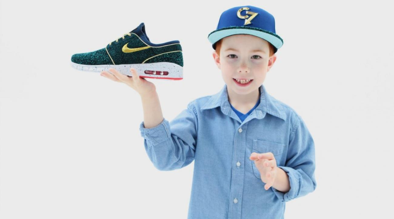 8-year-old Chase Crouch poses with the Stefan Janoski Max he designed