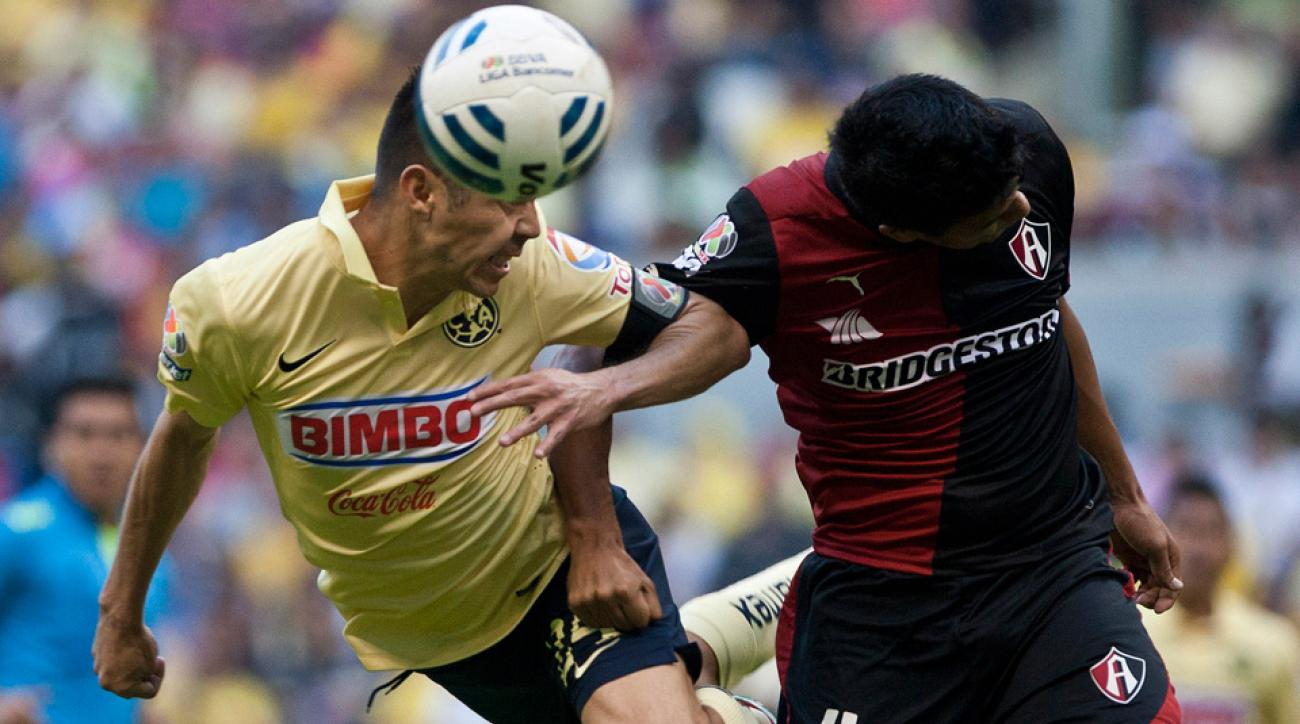 Oribe Peralta, left, and Club America nodded their way to the top of the Liga MX apertura regular-season standings.