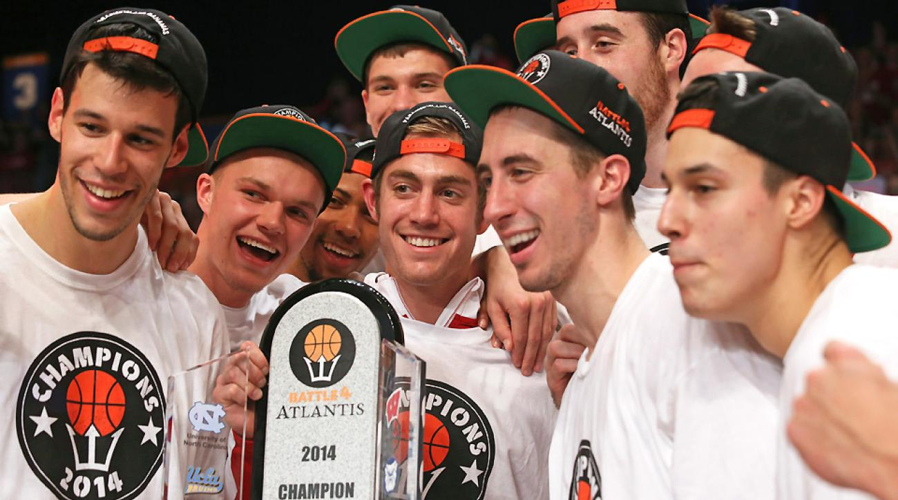 Wisconsin players celebrate receiving their Battle 4 Atlantis championship trophy.