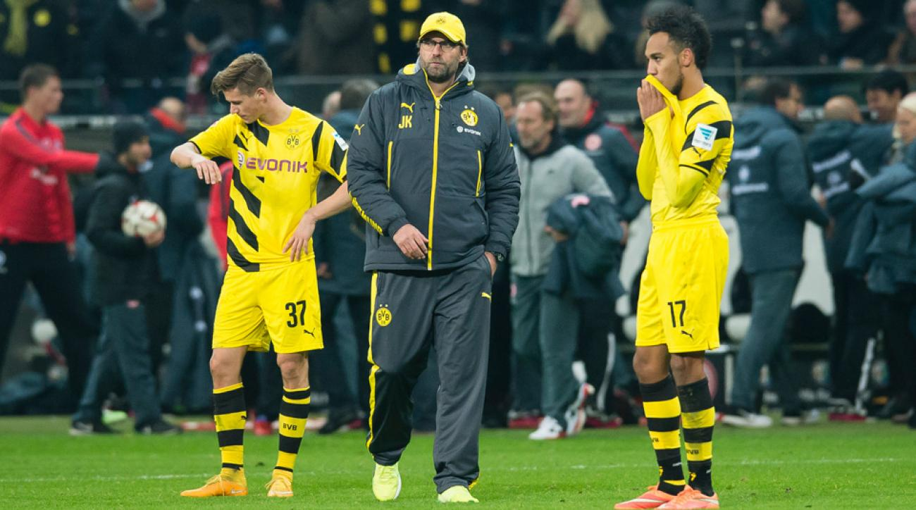It's been a Bundesliga season full of long faces and dejected looks for Borussia Dortmund manager Jurgen Klopp, center, and his players.