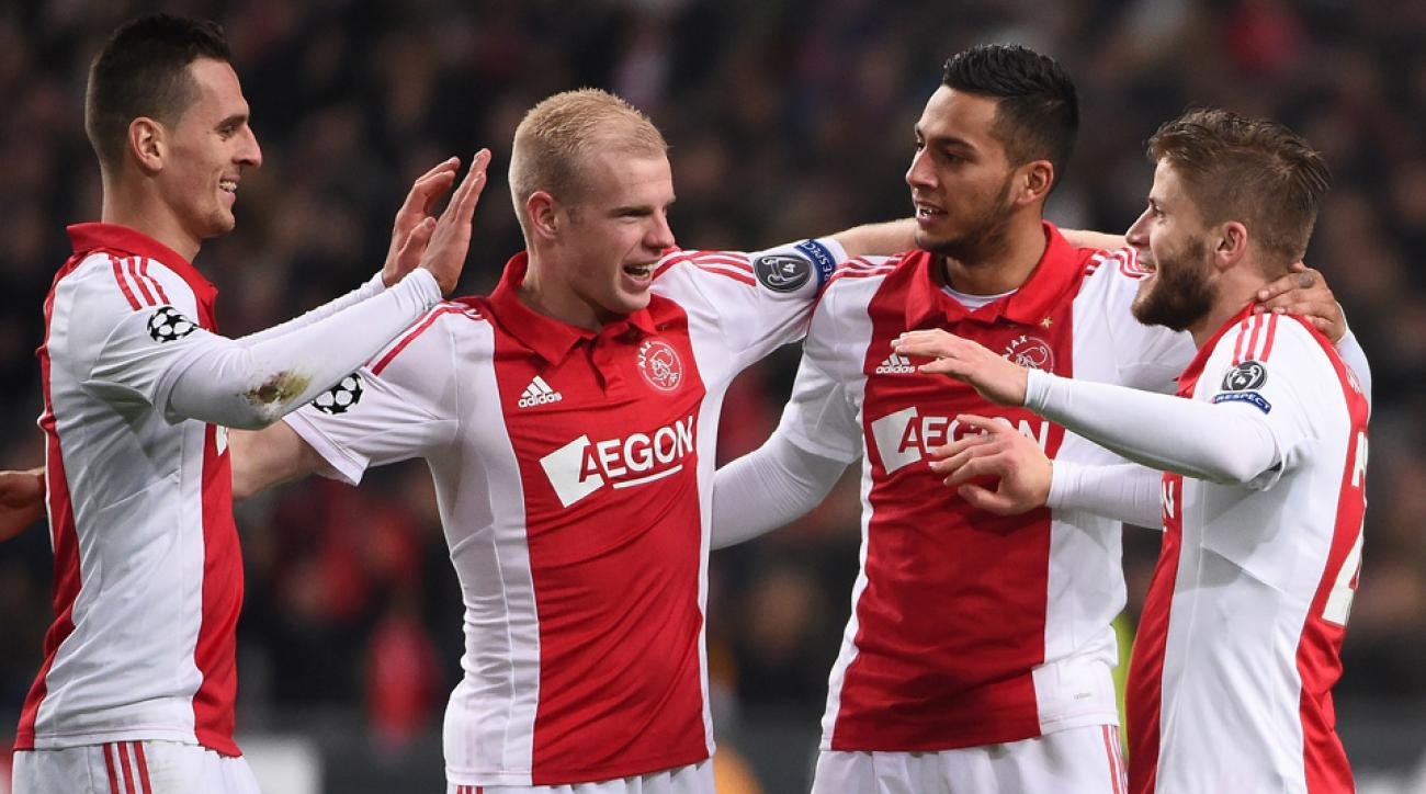 Ajax players celebrate a goal from Lasse Schoene, right, in a rout of APOEL in the Champions League.
