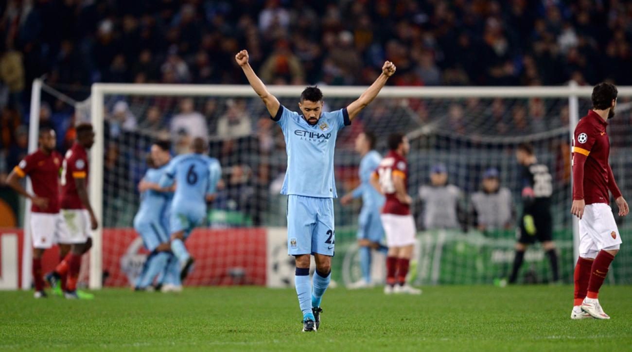 Gael Clichy's expression says it all, as Manchester City got the result it needed in Rome to advance to the Champions League knockout stage.