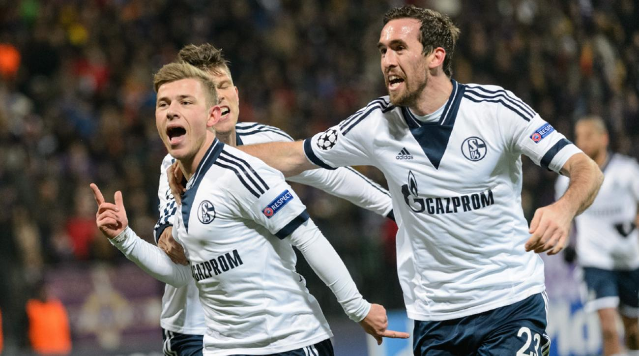 Max Meyer, left, celebrates his goal that put Schalke through to the Champions League knockout stage.