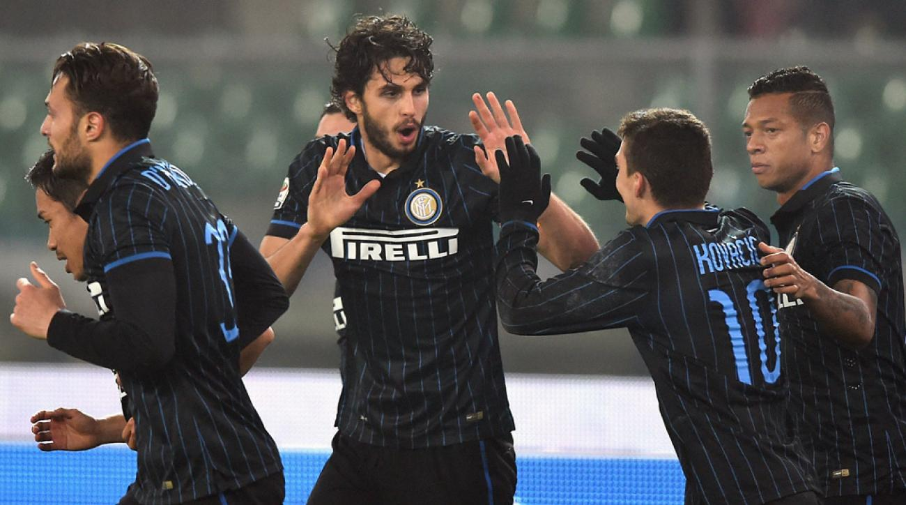 Andrea Ranocchia is congratulated by his Inter Milan teammates after scoring against Chievo Verona.