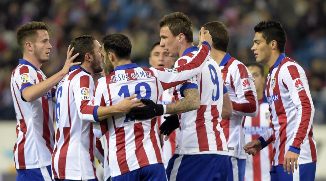 Mario Mandzukic (9) is congratulated by his Atletico Madrid teammates after scoring in the Copa del Rey.