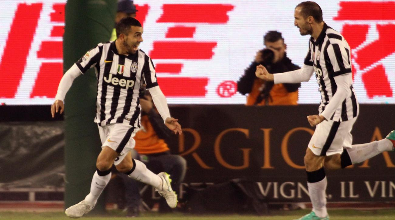 Carlos Tevez, left, celebrates his goal for Juventus in another Serie A victory for the three-time defending league champion.