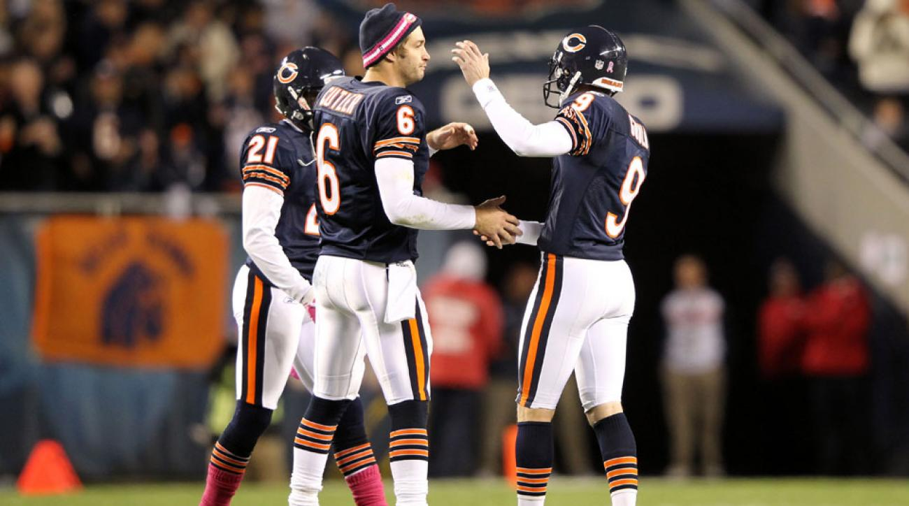 Robbie Gould #9 celebrates a field goal with Jay Cutler on October 16, 2011