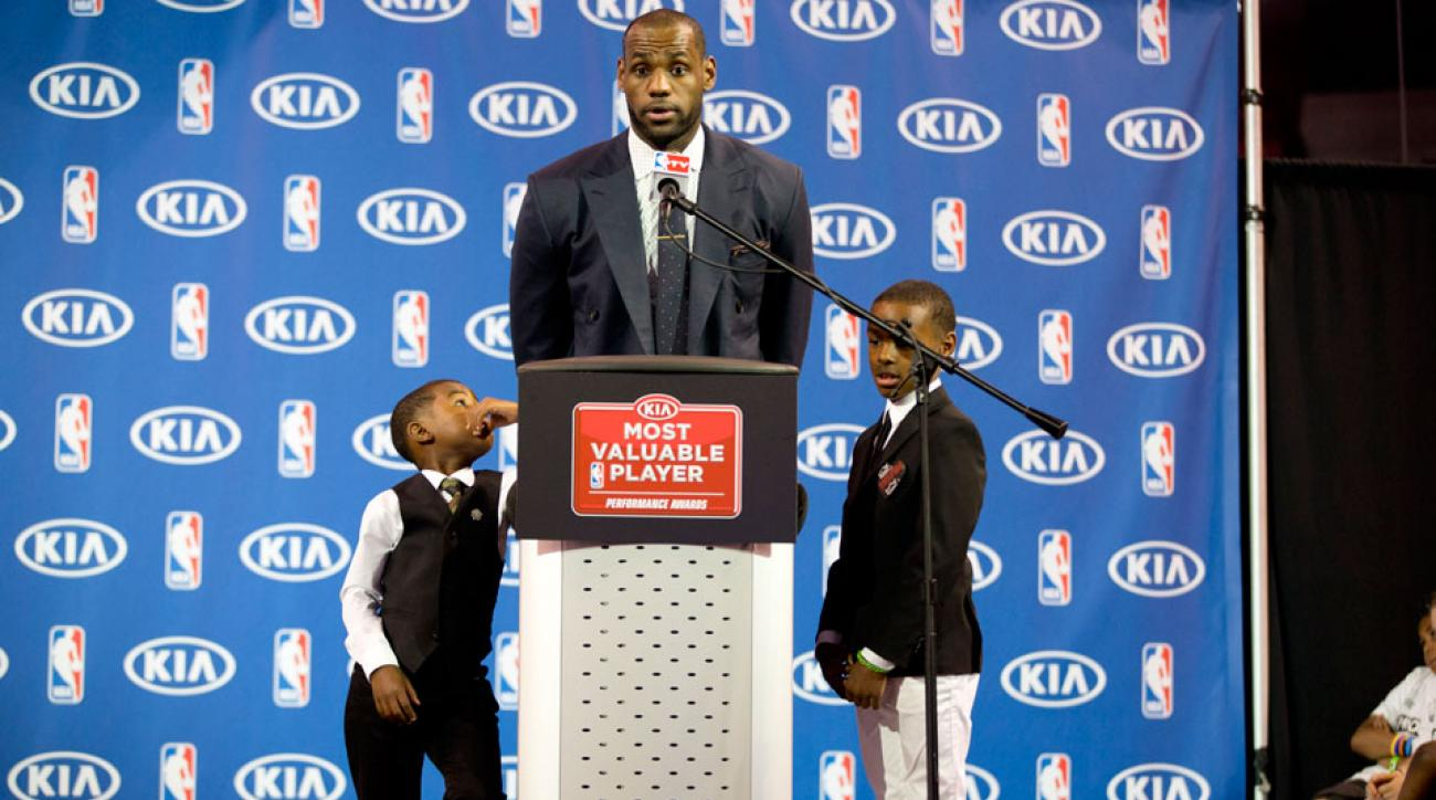Bryce and LeBron James Jr. listen to their father during an NBA basketball news conference, May, 5, 2013, in Miami.