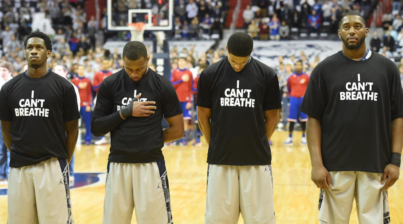 Members of the Georgetown University basketball team line up for the national anthem wearing 'I Can't Breathe' t-shirts to honor Eric Garner on Dec. 10, 2014.