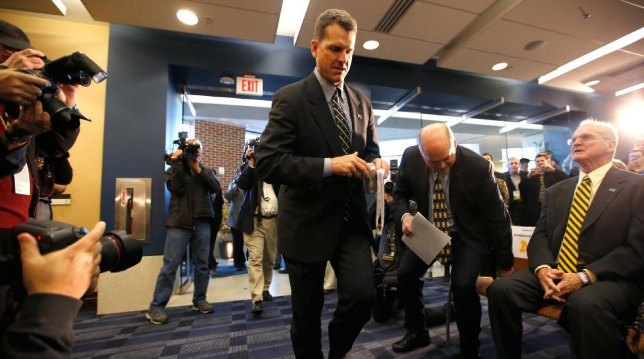 Jim Harbaugh stumbled into his first Michigan press conference