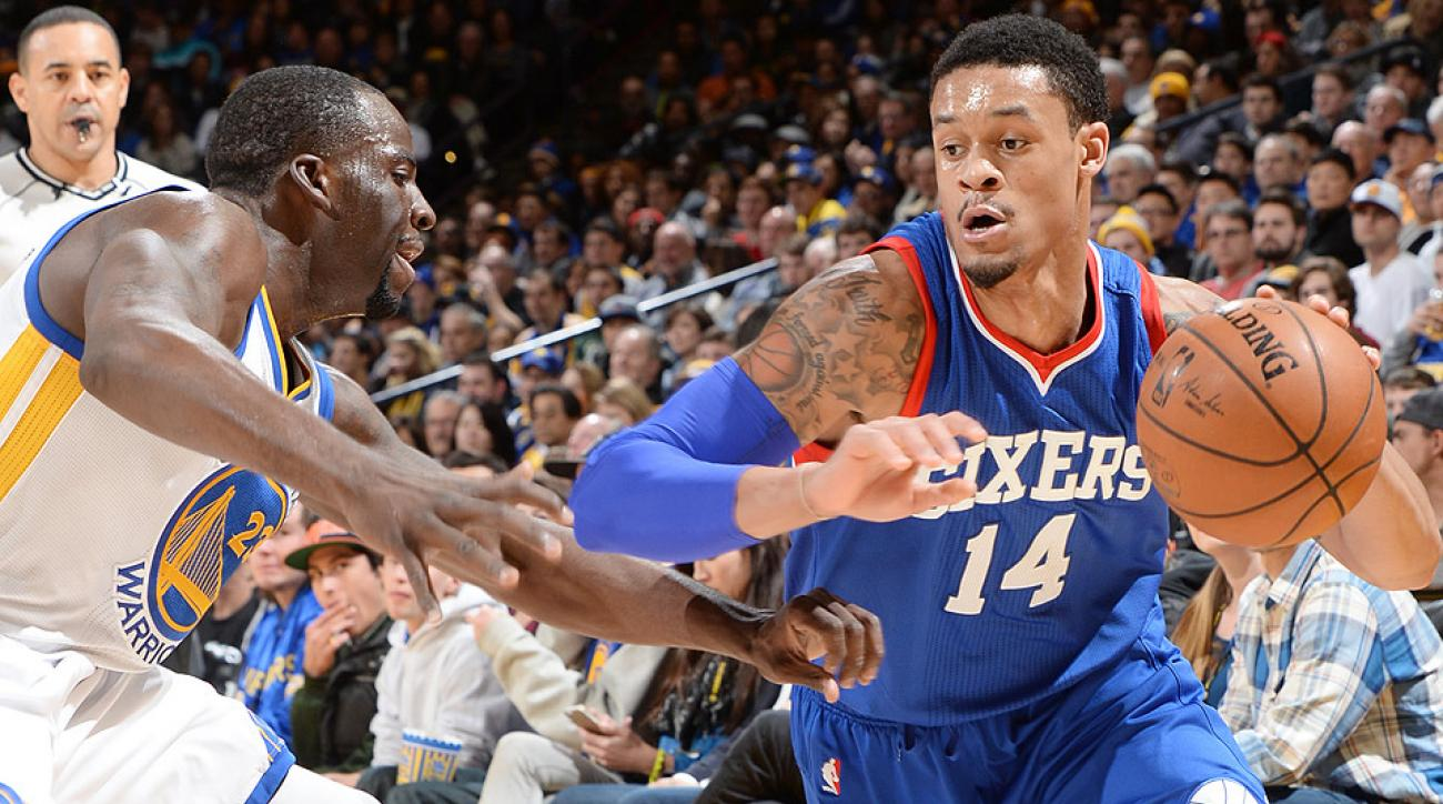 Sixers rookie K.J. McDaniels blocked a dunk by Warriors forward David Lee on Tuesday night.