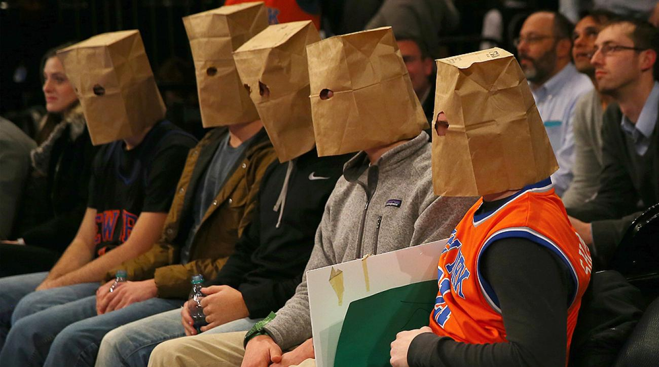 Knicks fans wore brown paper bags on their heads during New York's 120-96 loss to Houston.