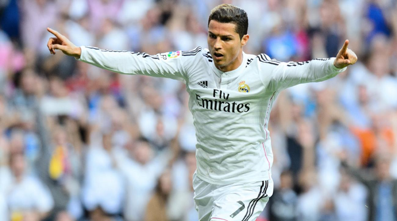 Cristiano Ronaldo earned the 2014 FIFA Ballon d'Or, beating finalists Lionel Messi and Manuel Neuer for top honors.