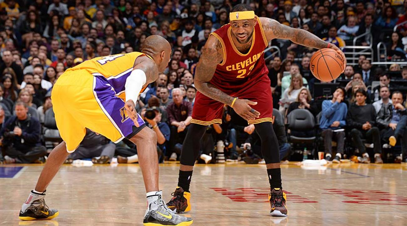 Kobe Bryant guards LeBron James