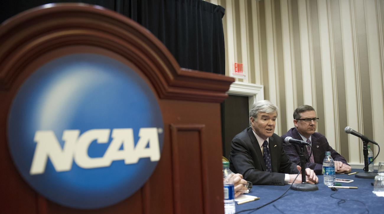 NCAA president Mark Emmert, left, and Division 1 board of directors member Kirk Schulz speak with reporters during a news conference at the NCAA Convention in Oxon Hill, Md., Friday, Jan. 16, 2015.