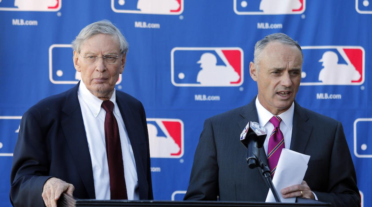 MLB commissioner Bud Selig, left, and commissioner-elect Rob Manfred speak with media during a news conference at owners meetings Jan. 15 in Phoenix.