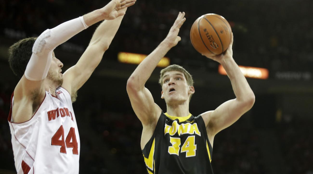 Iowa's Adam Woodbury denied that he intentionally poked Wisconsin players in the eye.