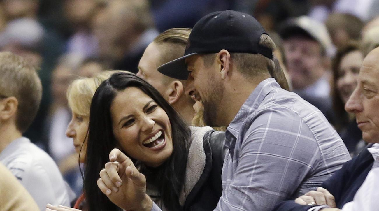 Olivia Munn and Aaron Rodgers at a Milwaukee Bucks game. Munn said on 'Conan' that she didn't know who Rodgers was when they met.