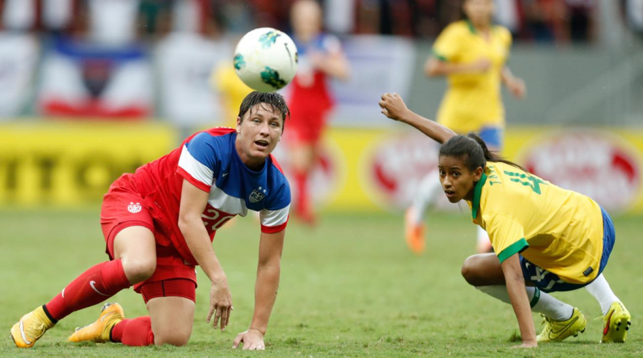 Abby Wambach, left, and the rest of the Women's World Cup players' fight against turf surfaces in Canada this summer is over.