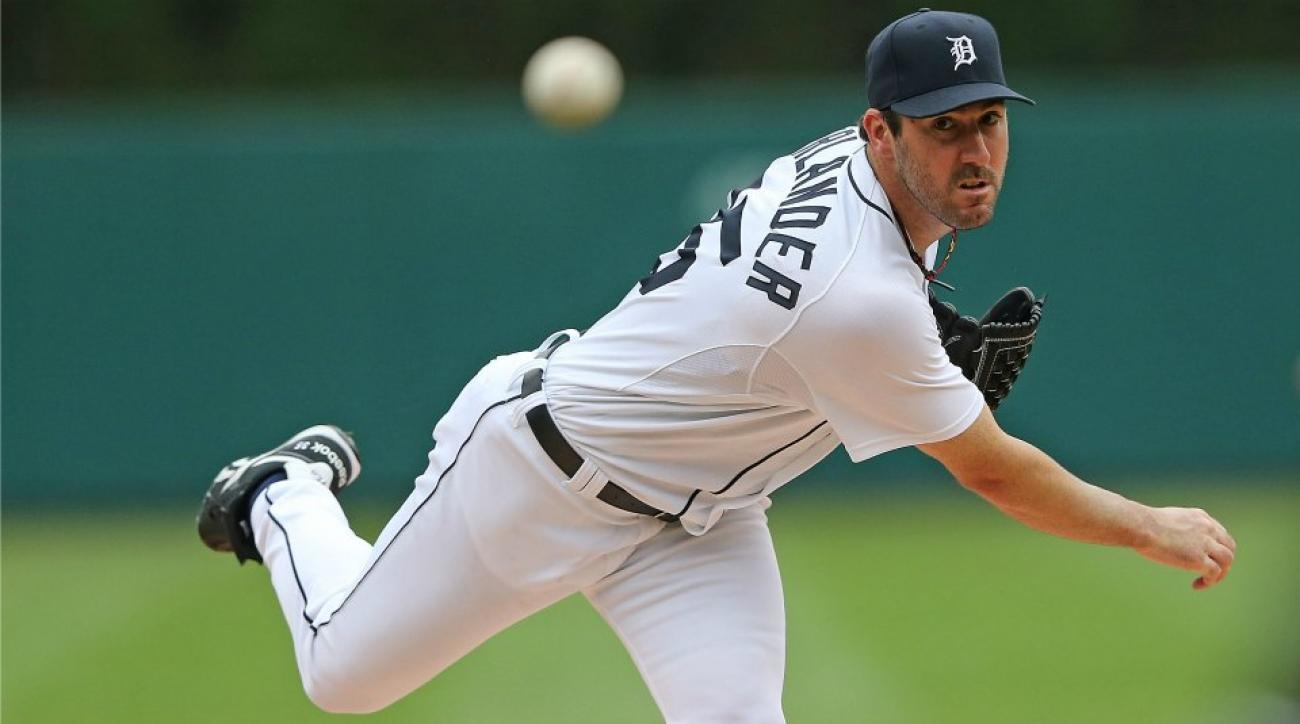Detroit Tigers' Justin verlander poses with a ton of money