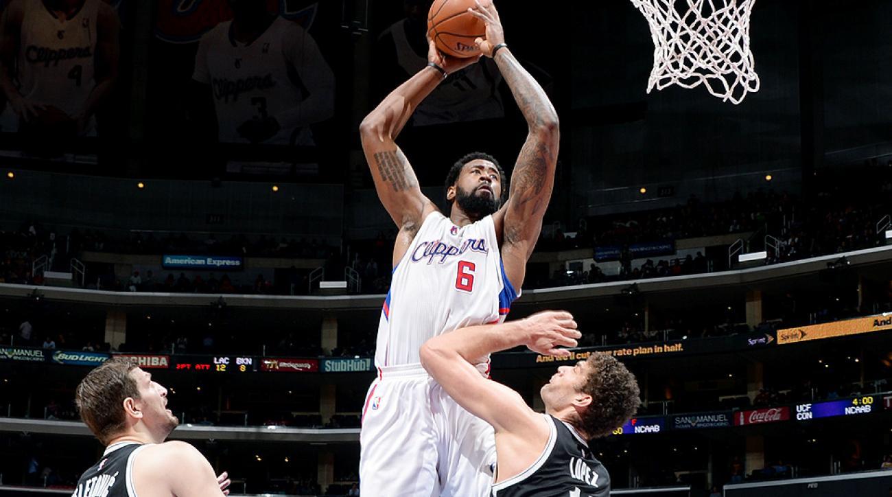 Clippers center DeAndre Jordan dunked over Nets center Brook Lopez.