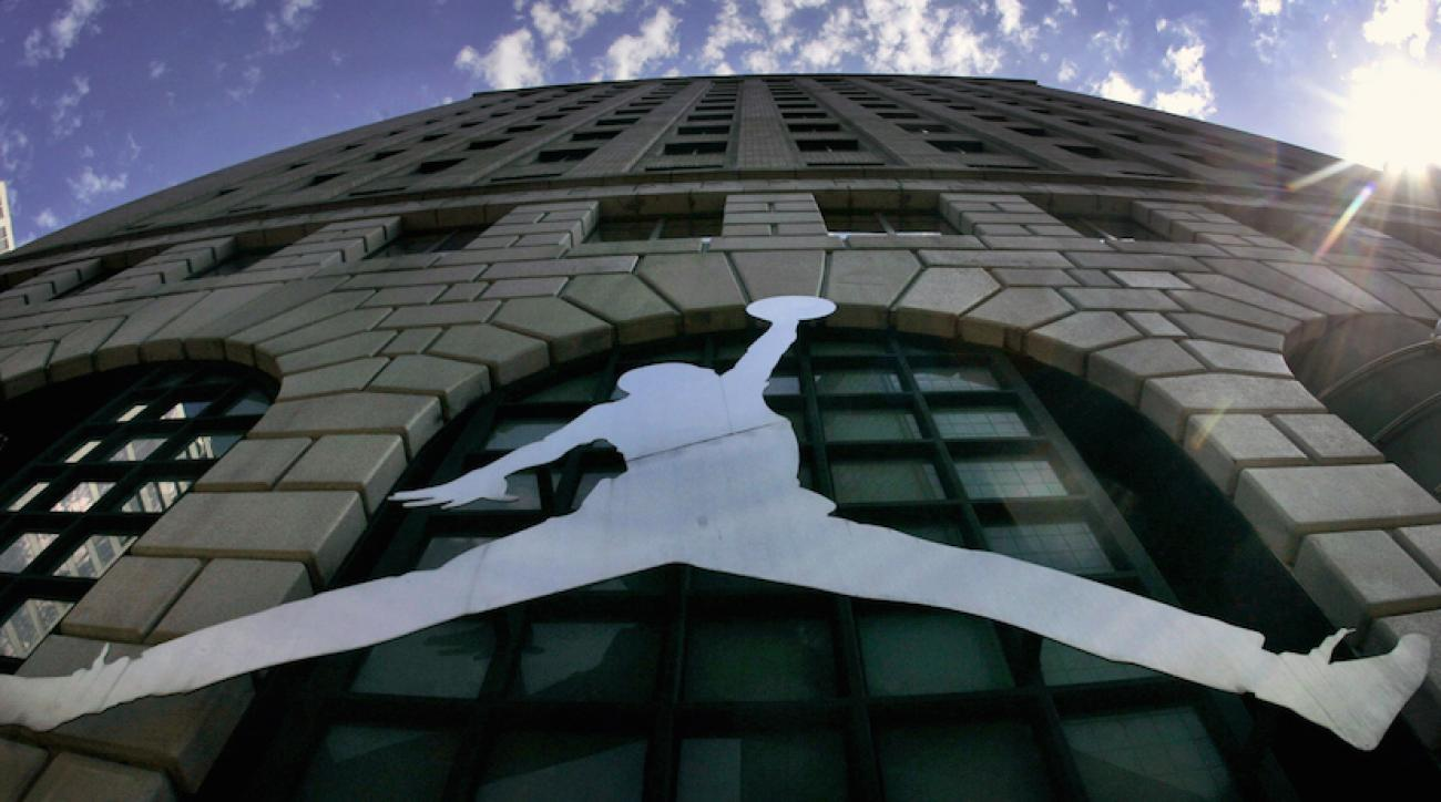 A Michael Jordan logo reflects off a Niketown store in Portland, Ore.