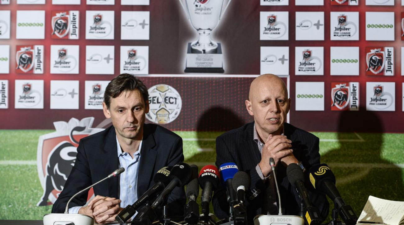 Pro League Director-General Ludwig Sneyers and KBVB-URBSFA Belgium soccer union general secretary Steven Martens (R) address the offensive banner in a press conference.