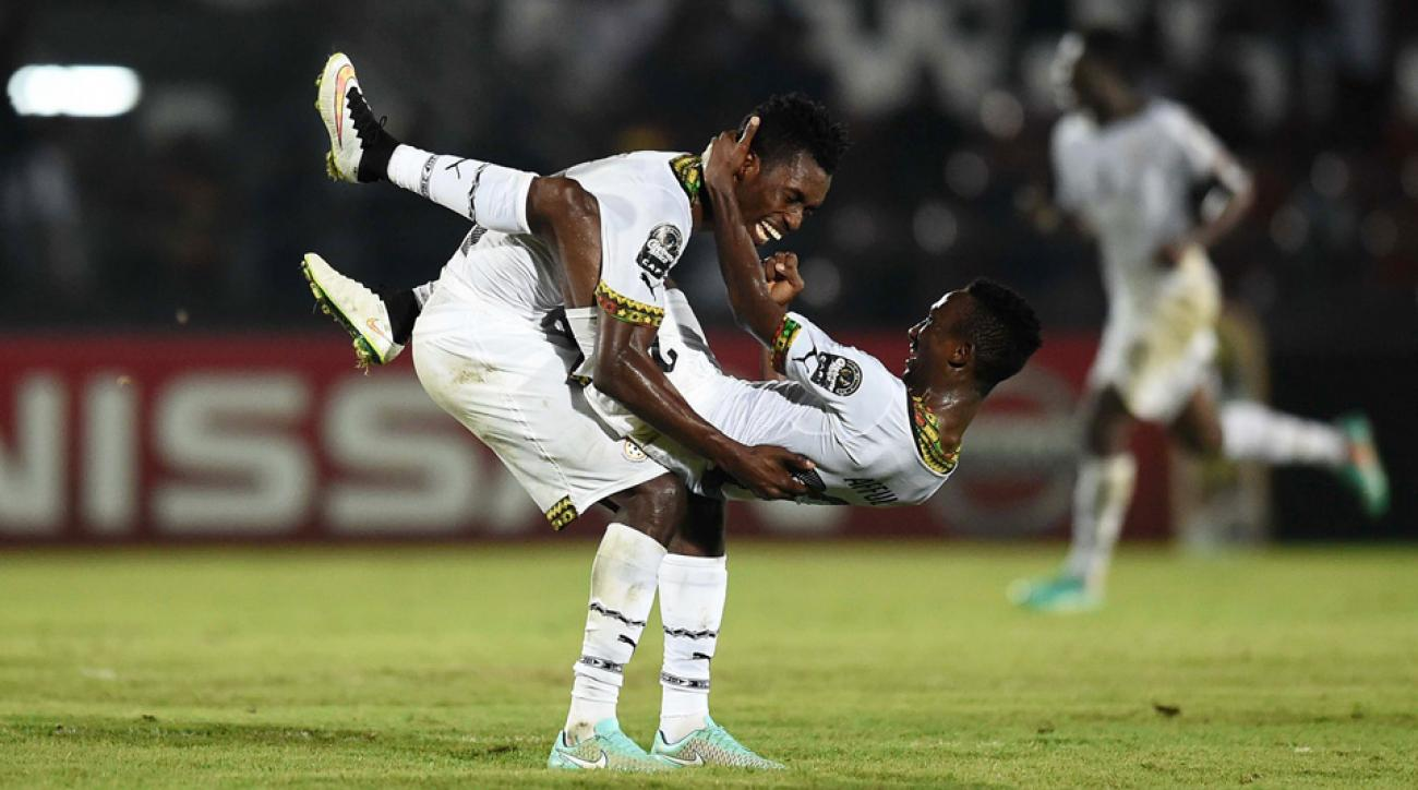 Ghana's John Boye, Harrison Afful celebrate advancement in the African Cup of Nations.